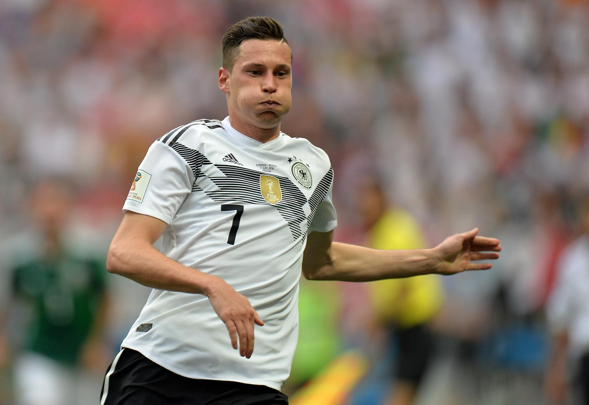 Julian Draxler Gives Himself A Spritz Of Scent Before