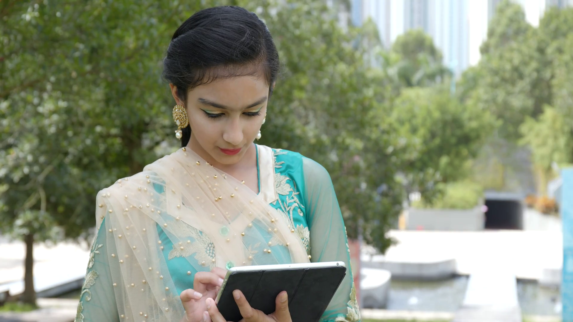 Young Pakistani Girl Using Tablet In The Park Stock