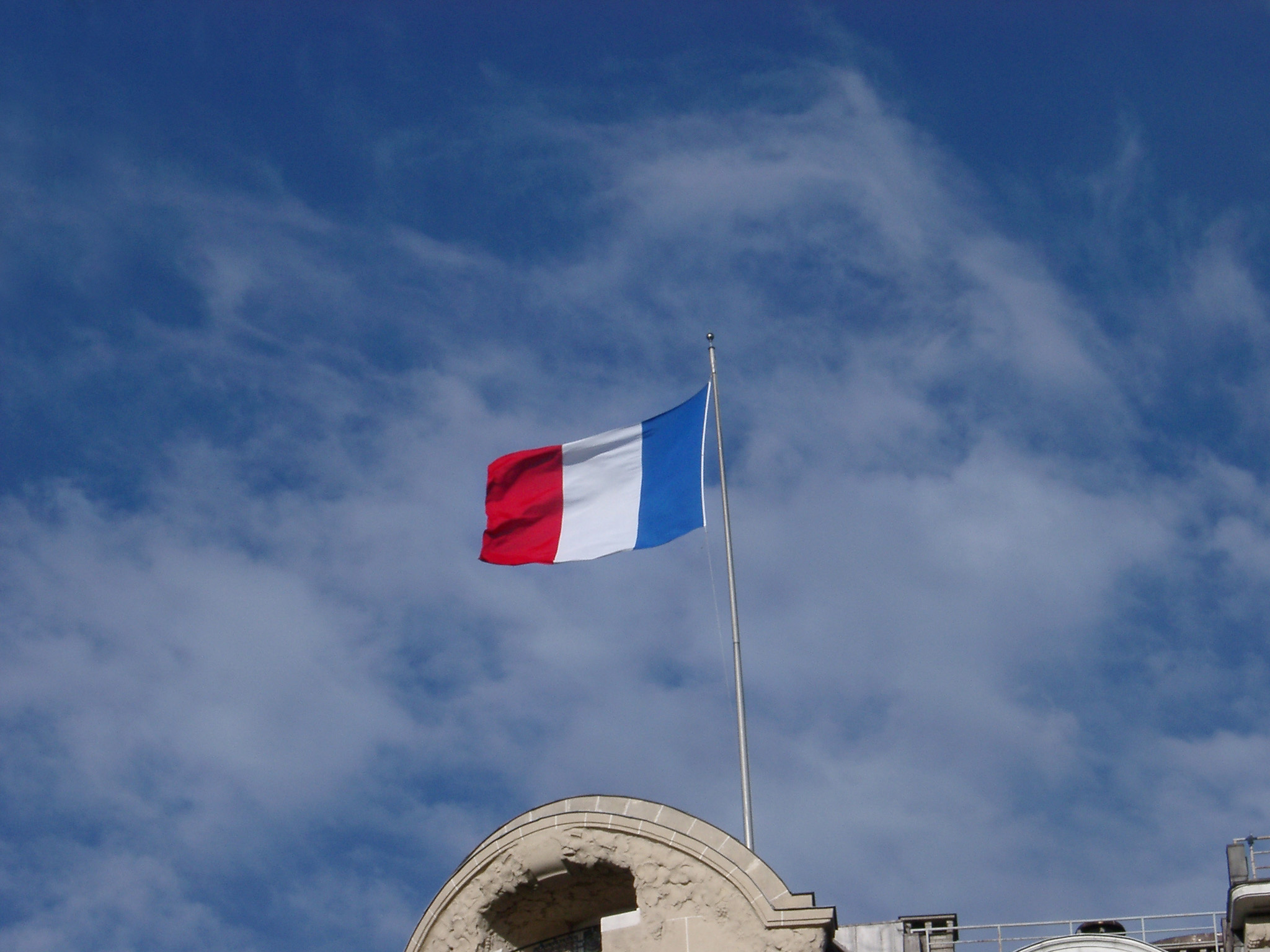 The Tricolor Or French National Flag Flying From A - Flying French Flag , HD Wallpaper & Backgrounds