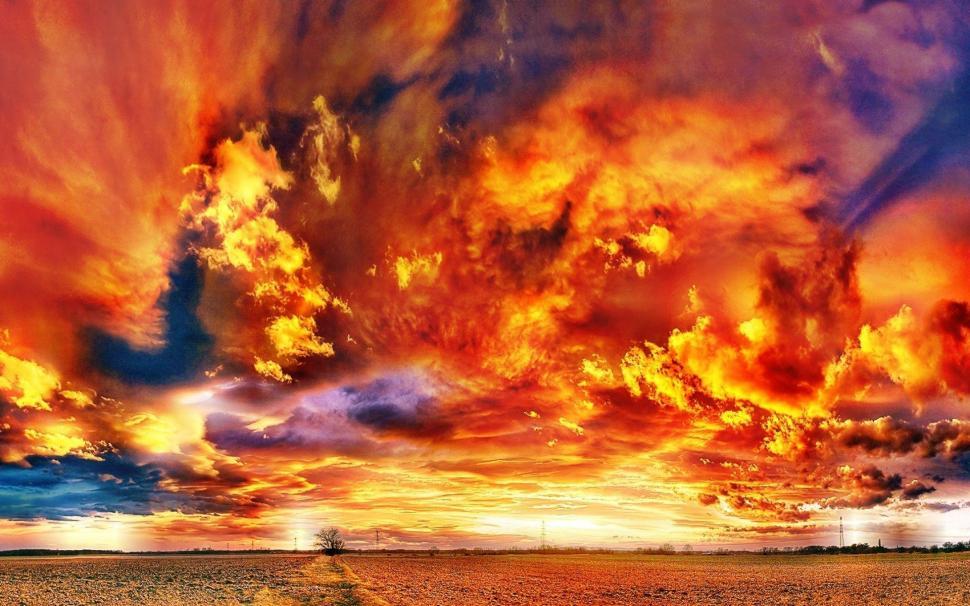 Fiery Clouds Over A Sunset Field Wallpaper Fire Clouds