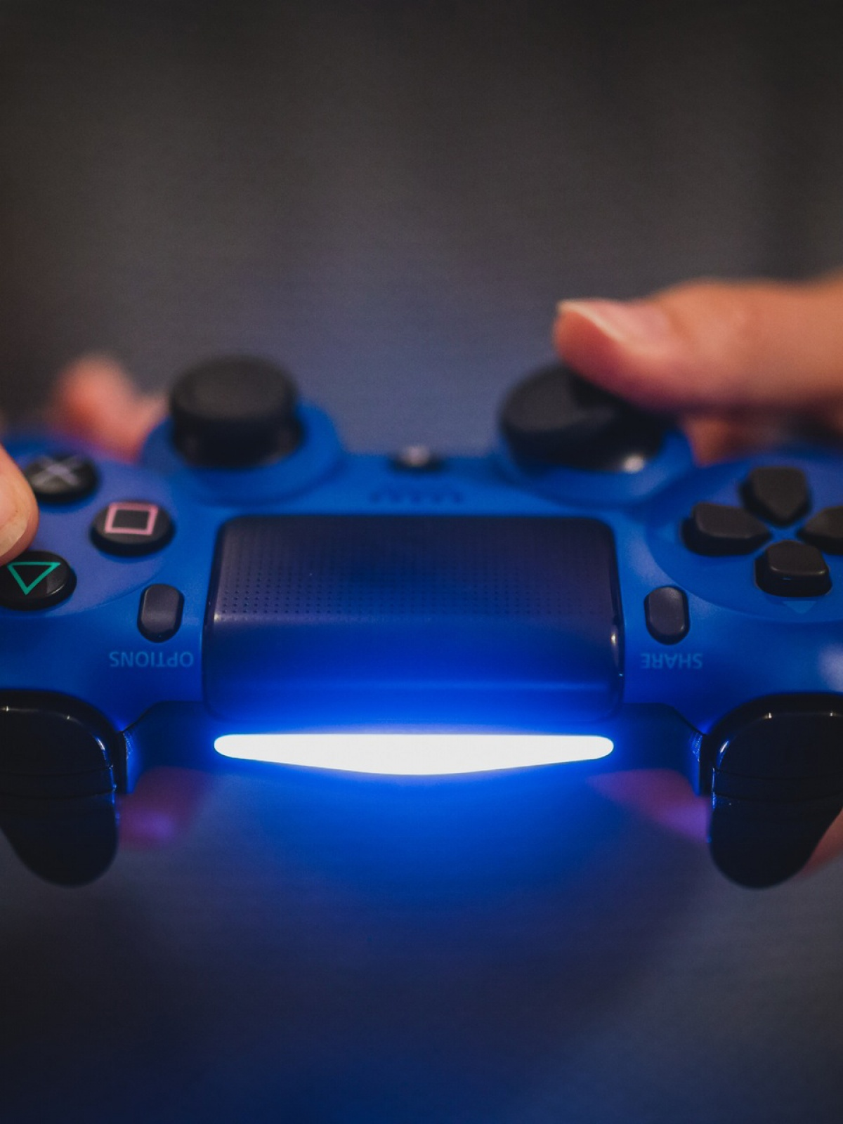 Person Holding Blue Sony Ps4 Controller Hd Wallpaper Video
